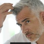 Why does some people's hair start to turn white at a young age?